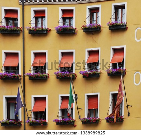 italianate windows with blinds  #1338989825