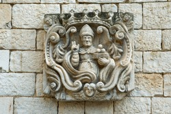 Italy, Apulia, capital city of Bari, Bari, The Pontifical Basilica di San Nicola (Basilica of Saint Nicholas). Stone carving on the wall of the Basilica of San Nicola.