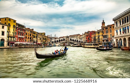 Italy beauty, gondola near to famous Rialto bridge on Grand canal street in Venice, Venezia #1225668916