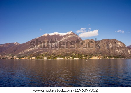 Italy, Bellagio, Lake Como, SCENIC VIEW OF SNOWCAPPED MOUNTAINS AGAINST BLUE SKY #1196397952