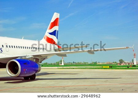 Italy, Bologna airport, airplane just landed. - stock photo