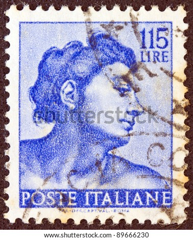 "ITALY - CIRCA 1961: A stamp printed in Italy from the ""Michelangelo"" issue shows a head of the ""Ignudi"" from Sistine Chapel, circa 1961."