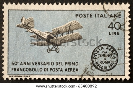 ITALY - CIRCA 1967: a stamp printed in Italy shows a biplane illustration, celebrating 50th anniversary of italian air mail. Italy, circa 1967