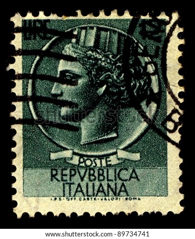 ITALY-CIRCA 1955:A stamp printed in Italy shows image of Italia Turrita is the national personification of Italy, characterised by a mural crown typical of Italian civic heraldry, circa 1955.
