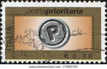 ITALY - CIRCA 2004: A stamp printed in Italy shows sign of Priority Mail, circa 2004