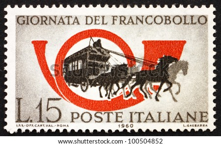 ITALY - CIRCA 1960: a stamp printed in the Italy shows Mail Coach and Post Horn, Stamp Day, circa 1960