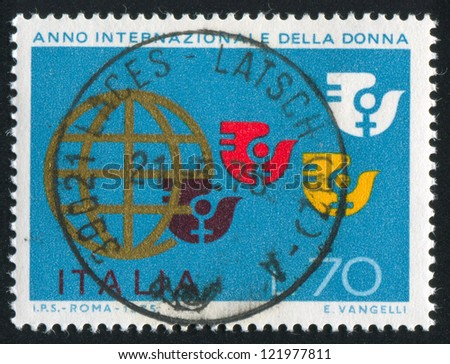 ITALY - CIRCA 1975: stamp printed by Italy, shows Globe and International Womens Year emblem, circa 1975