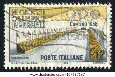 ITALY - CIRCA 1956: stamp printed by Italy, shows Stadium at Cortina, Skiing, circa 1956 - stock photo