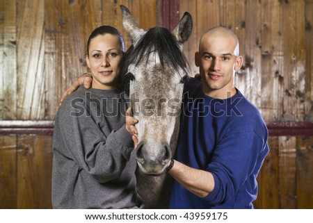 Italy, countryside, young couple with a horse