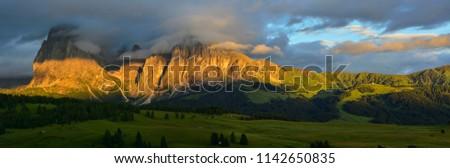Italy Dolomites Alpe di Siusi Plattkofel Langkofel sunset panorama #1142650835