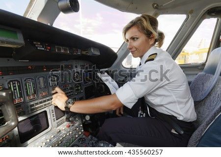 Italy, female pilot in an airplane\'s cockpit
