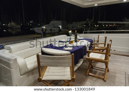 Italy, Fiumicino (Rome), RIZZARDI TEKNEMA 65 luxury yacht, stern deck and external dinner table
