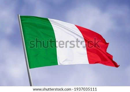 Italy flag isolated on sky background. close up waving flag of Italy. flag symbols of Italy.