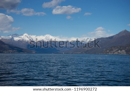 Italy, Lecco, Lake Como, SCENIC VIEW OF SNOWCAPPED MOUNTAINS AGAINST BLUE SKY, Lombardy #1196900272