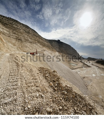 Italy, Maddaloni (Naples), stone pit with industrial vehicles at work