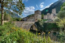 Italy. Marche. Ancona. San Vittore alle Chiuse. Roman Catholic abbey and church. The edifice is known from the year 1011. Ponte Romano. Roman bridge over a small river.