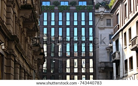 Italy, Milano: Reflection of old houses in glass house. #743440783