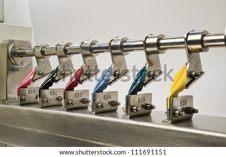 Italy, Naples, cow leather samples on a stretch test machine in a leather factory