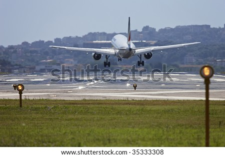ITALY, Naples, international airport Capodichino, airplane landing and flight control lights