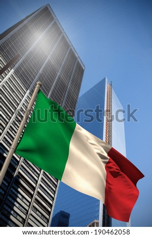 Italy national flag against low angle view of skyscrapers