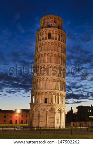 italy Pisa town landmark leaning tower of Pisa at sunrise dark cloudy sky highlighted tower and nobody