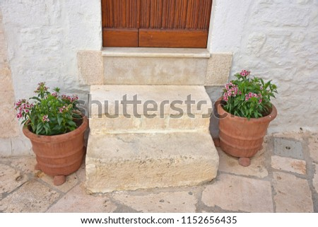 Italy, Puglia region, Locorotondo, 1 May 2018, a whitewashed village in the Itria valley, with its medieval historical center full of stairs, balconies, flowers, arches, frescoed churches, and details #1152656435