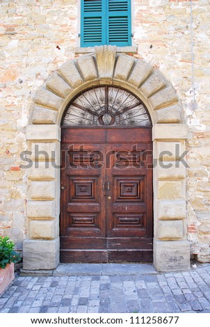 Italy. Romagna Apennines, San-Leo village ancient building entrance.