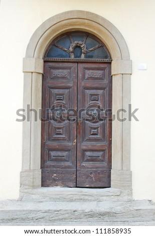 Italy. Romagna Apennines, San-Leo village antique building door
