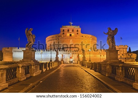Italy Rome ancient landmark ruins of old roman castle St Angelo modern christian church bridge with statues leading to the castle at sunrise illuminated lights