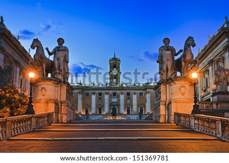 Italy rome capital city capitoline hill square with surrounding museums marble statues and monuments at sunrise palace with clock tower cultural ancient landmark