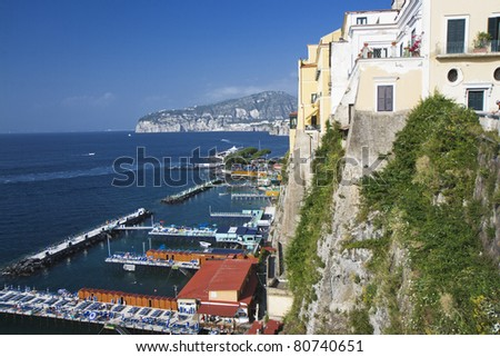 Italy: seascape of Sorrento with boats in the harbour