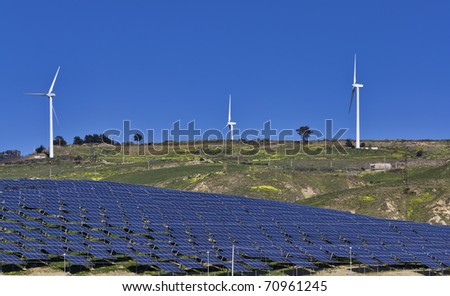 ITALY, Sicily, Agrigento province, countryside, Eolic energy turbines and solar energy panels