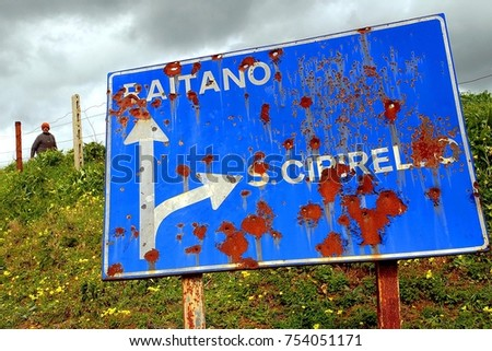 Stock Photo italy- sicily- corleone - road signs hit by mafia gunshots