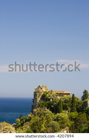 italy sicily mansion on island overlooking sea taormina view