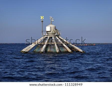Italy, Sicily, Mediterranean sea, aquaculture nets off the coast of Portopalo di Capo Passero (Siracusa province)