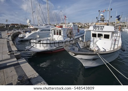 Italy, Sicily, Mediterranean sea, Marina di Ragusa; 22 December 2016, fishing boats and luxury yachts in the port - EDITORIAL #548543809
