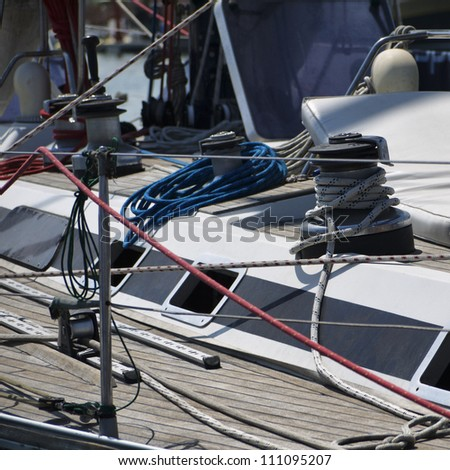 Italy, Sicily, Mediterranean Sea, sailing boat in a marina, winch and nautical cables