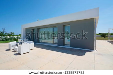 Italy, Sicily, Ragusa Province, countryside; 26 May 2018, elegant private house, view of the patio by the swimming pool - EDITORIAL #1338873782