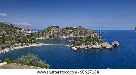 Italy, Sicily, Taormina bay, panoramic view of Capo Taormina and Isola Bella, Calabria coastline in the far background