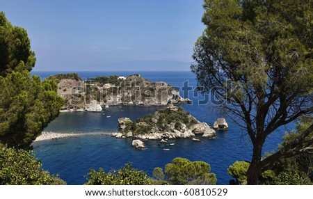 Italy, Sicily, Taormina bay, view of Capo Taormina and Isola Bella, Calabria coastline in the far background