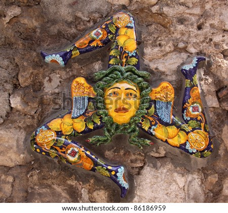 Italy, Sicily, Taormina. Trinacria ancient symbol of Sicily in typical Sicilian glazed ceramic