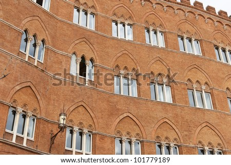 Italy, Siena. Palazzo Sansedoni located on the Piazza del Campo - stock photo