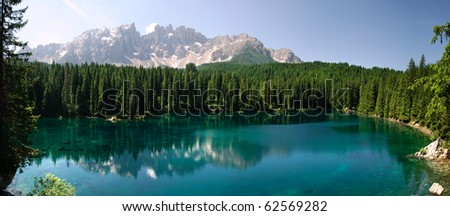 Italy, Trentino, scenic lake with reflections caress