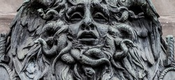 Italy, Turin. This city is famous to be a corner of two global magical triangles. This is a Medusa's head made of bronze close to the historical garden of Valentino in Turin.