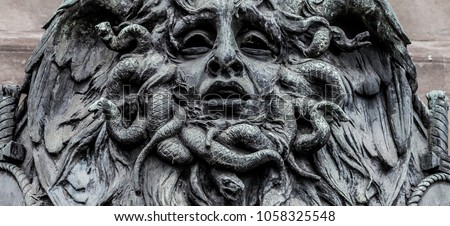 Italy, Turin. This city is famous to be a corner of two global magical triangles. This is a Medusa's head made of bronze close to the historical garden of Valentino in Turin. #1058325548