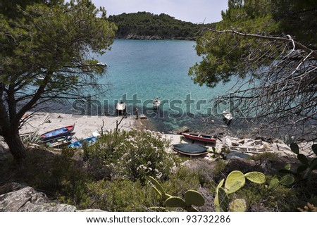 Italy, Tuscany, Elba Island, tourists in a bay near Porto Azzurro