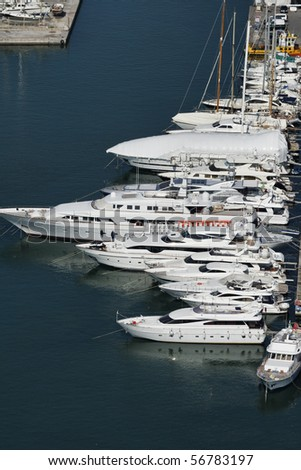 Italy, Tuscany, Viareggio, aerial view of luxury yachts in the port