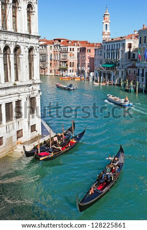 ITALY, VENICE - FEB 8: Gondolas on the Grand Canal seen from the Rialto bridge on February 8, 2013 in Venice. Gondola's today are mostly used by tourists in Venice, Italy.