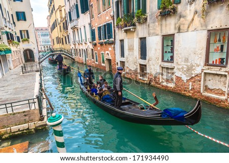 ITALY, VENICE - FEB 7: Gondolier on a gondola on the Grand Canal on February 7, 2013 in Venice. Gondola's are a major mode of touristic transport in Venice, Italy. #171934490
