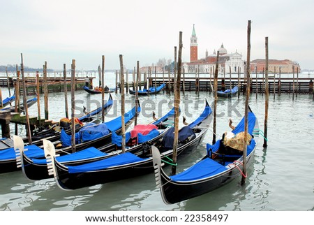 Italy, Venice gondola parking at sunset